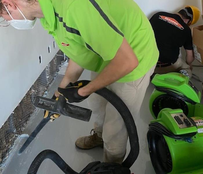 technician vacuuming during water mitigation